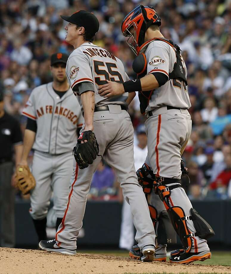 Tim Lincecum is checked out by Buster Posey after Lincecum slipped and fell as he started to throw a pitch, causing a balk. Photo: David Zalubowski, Associated Press