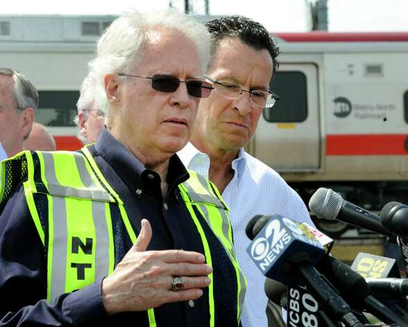 NTSB member Earl Weener, with Gov. Dannel Malloy, addresses the media at a press conference near the scene of Friday evening's Metro-North train collision that left more than 60 people injured. Investigators from National Transportation Safety Board were in Bridgeport, Conn. on Saturday May 18, 2013 to find the cause of the crash. Weener said the investigation is focusing on a variety of focal areas including braking performance, condition of wheel, condition of tracks and signals. Photo: Cathy Zuraw / Connecticut Post