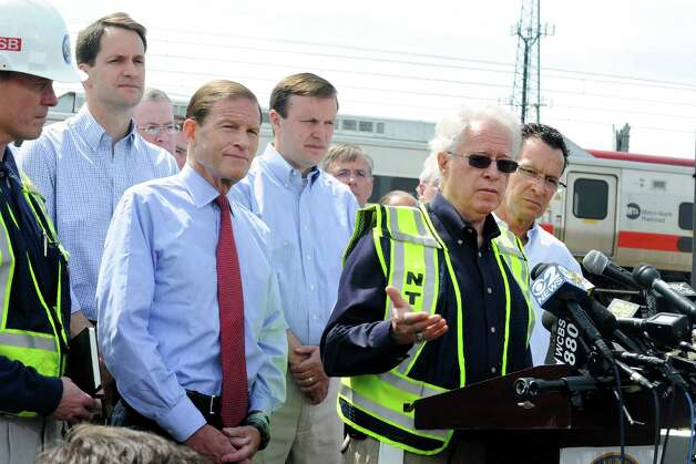 NTSB member Earl Weener addresses the media at a press conference near the scene of Friday evening's Metro-North train collision that left more than 60 people injured. Also on the scene were Congressman Jim Himes, Senator Dick Blumenthal, Senator Chris Murphy and Gov. Dannel Malloy. Investigators from National Transportation Safety Board were in Bridgeport, Conn. on Saturday May 18, 2013 to find the cause of the crash. Weener said the investigation is focusing on a variety of focal areas including braking performance, condition of wheel, condition of tracks and signals. Photo: Cathy Zuraw / Connecticut Post