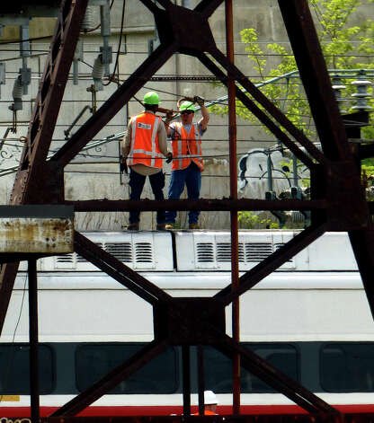 Metro-North Railroad workers on the scene of Friday's commuter train derailment in Bridgeport, Conn. on Saturday May 18, 2013. Photo: Christian Abraham / Connecticut Post