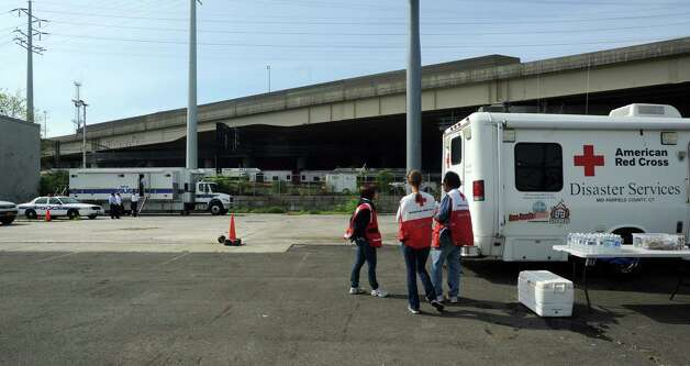 The Red Cross was on hand at the MTA police command center near the scene of Friday evening's Metro-North train collision that left more than 60 people injured. Investigators from National Transportation Safety Board came to Bridgeport, Conn. on Saturday May 18, 2013 to investigate the cause of the accident. Photo: Cathy Zuraw / Connecticut Post