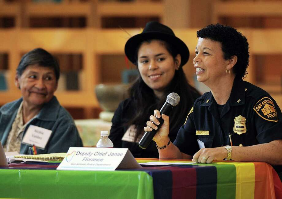 Deputy Chief Janae Florance speaks during the panel discussion on equality issues as Melissa Ruizesparza Rodriguez (center) and Nickie Valdez look on at the First Unitarian Universalist Church. Photo: Darren Abate / For The San Antonio Express-News