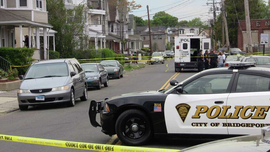 Police are investigating an apparent domestic dispute that resulted in a man being crushed between a wall and a red Pontiac Saturday morning. Photo: Steve Krauchick / Connecticut Post contributed
