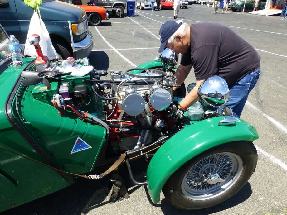 Jack Harris working on the cooling system of a 1949 MGTC that belongs to Jim and Lori Buell of Blanchard, Idaho.