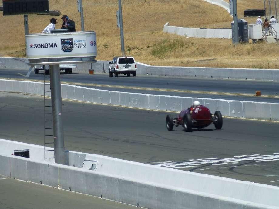 A pre-war racer passing the Sonoma Raceway grandstand.