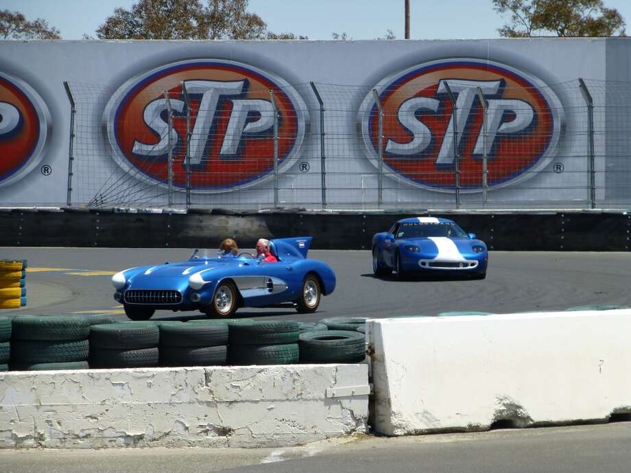 During the parade of Corvettes, a 1956 SR2 (left) leads a 1993 ZR1 LT5 modified by Dick Gulstrand.