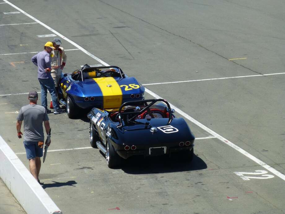 A pair of Corvettes waiting to get out on the track.