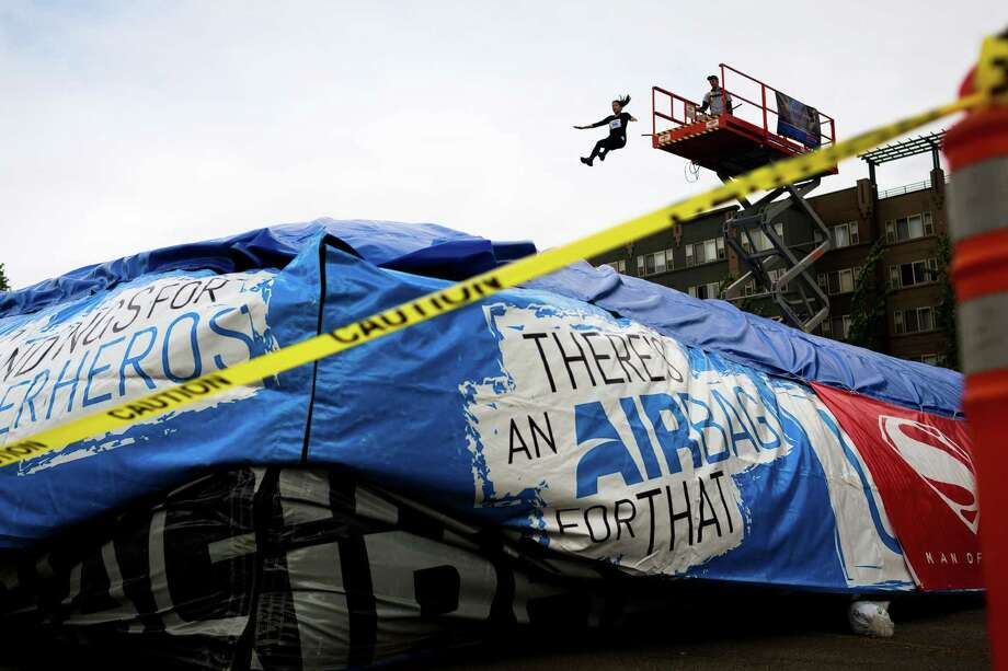 One at a time, runners plunged from the height of a lift into a gigantic airbag at one of the stations during the Great Urban Race Saturday, May 18, 2013, in Seattle. An estimated 400 runners competed. Teams of runners were given five hours to visit 12 unique checkpoints and return to the starting point. The top three winning teams went on to compete in the national tour. Photo: JORDAN STEAD, SEATTLEPI.COM / SEATTLEPI.COM