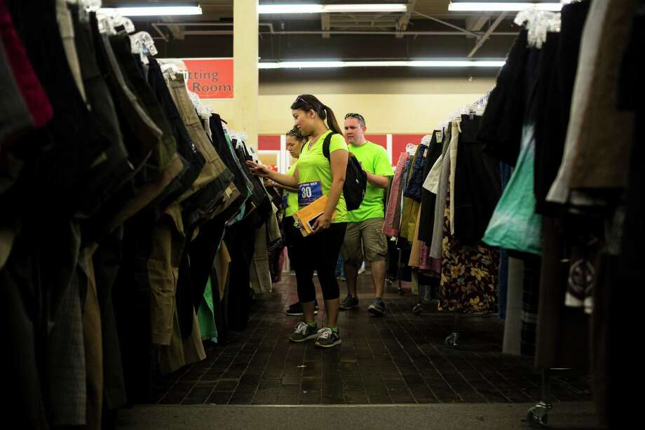At Value Village on Capitol Hill, teams picked out thrifty outfits that totaled 23 dollars in order to progress to the next station during the Great Urban Race Saturday, May 18, 2013, in Seattle. An estimated 400 runners competed. Teams of runners were given five hours to visit 12 unique checkpoints and return to the starting point. The top three winning teams went on to compete in the national tour. Photo: JORDAN STEAD, SEATTLEPI.COM / SEATTLEPI.COM