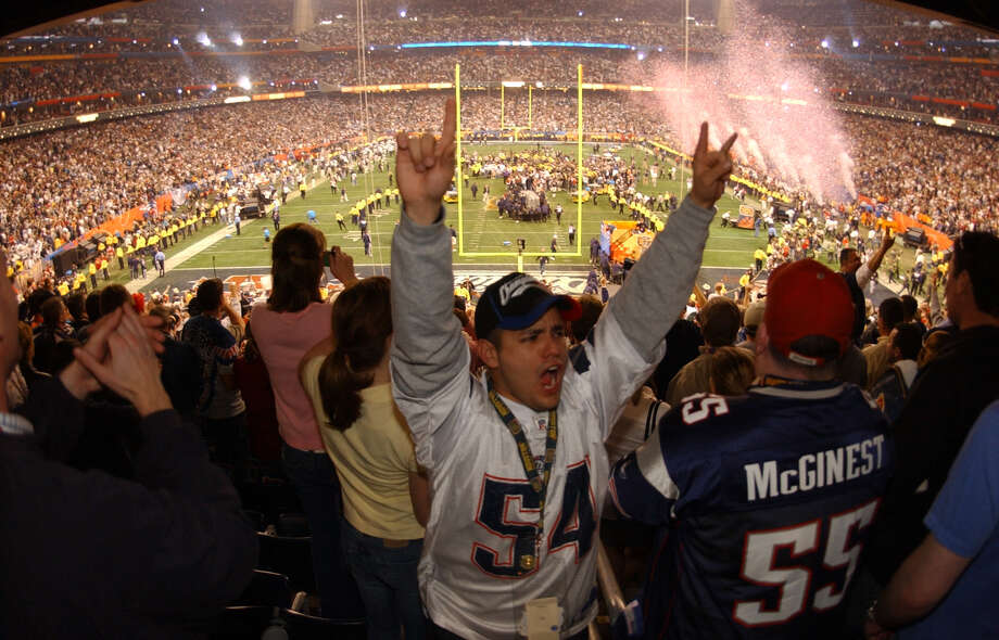Patriots fans celebrate the teams 32-29 victory over the Carolin Panthers in Superbowl XXXVIII at Reliant Stadium in Houston Sunday 2/1/04. Photo: Bahram Mark Sobhani, Hearst Newspapers / San Antonio Express-News