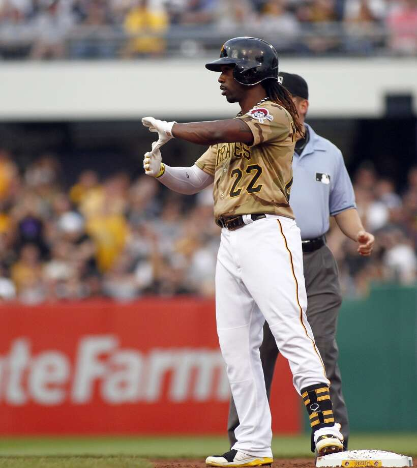 Andrew McCutchen #22 of the Pirates reacts after hitting a double.