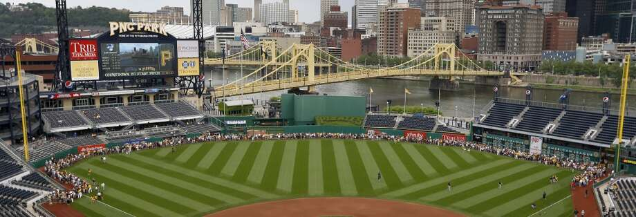 Fans line the warning track along the edge of the outfield at PNC Park as part of the Pirates Photofest before the game.