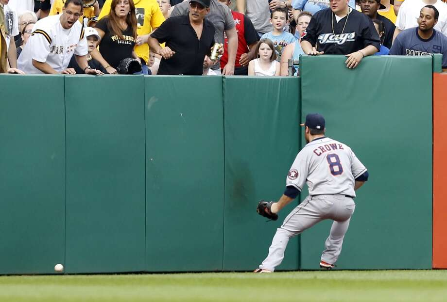 Astros left fielder Trevor Crowe (8) chases after a double hit by Gaby Sanchez that drove in Andrew McCutchen in the first inning.