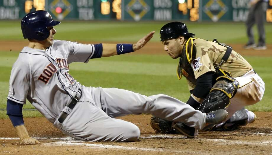 May 18: Astros 4, Pirates 2 (11)Jason Castro, left, scores from third on a ground ball by Matt Dominguez as Pirates catcher Russell Martin, right, tries to tag him in the 11th inning.