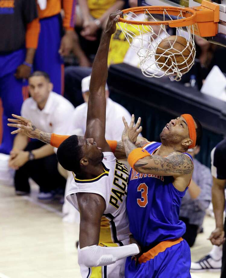 Indiana Pacers center Roy Hibbert, left, dunks over New York Knicks guard James White during the third quarter of Game 6 of the Eastern Conference semifinal NBA basketball playoff series in Indianapolis, Saturday, May 18, 2013. (AP Photo/Michael Conroy) Photo: Michael Conroy