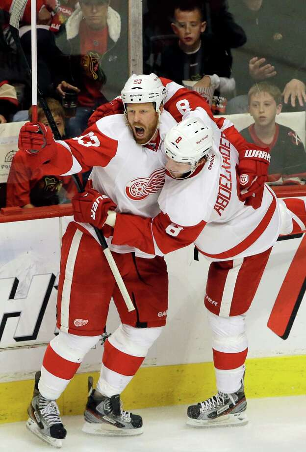 Johan Franzen, left, gave the Red Wings a two-goal lead over the Hawks in the third period. Photo: Nam Y. Huh, STF / AP