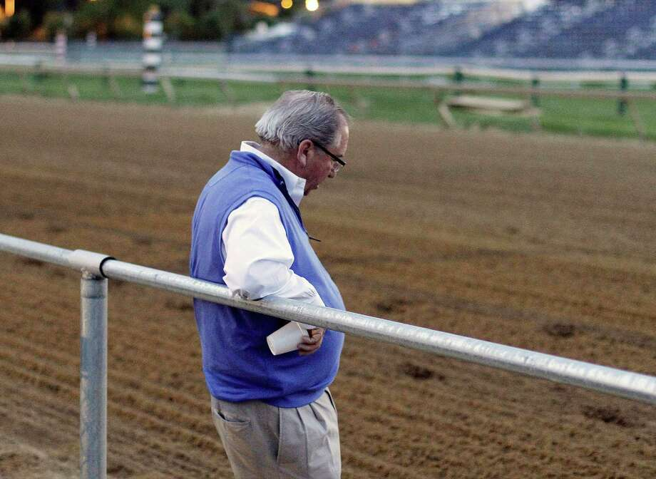 "Hall of Fame trainer Claude R. ""Shug"" McGaughey, who will send Kentucky Derby winner Orb to the gate in the 138th Preakness Stakes, is deep in thought on the track at Pimlico Race Course early Saturday, May 18, 2013 in Baltimore. (AP Photo/Garry Jones) Photo: Garry Jones"