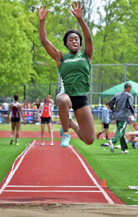 Shen's Toluwa Akinyemi competes in long jump during the annual high school track and field Eddy Meet at Schenectady High School in Schenectady, NY Saturday May 18, 2013.  (John Carl D'Annibale / Times Union) Photo: John Carl D'Annibale / 00022412A