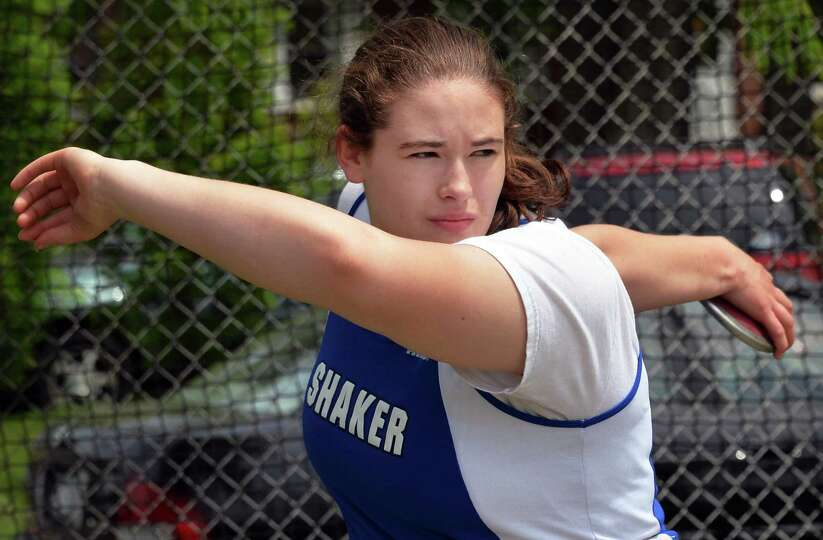 Shaker's Becky Rossier throw the discus during the annual high school track and field Eddy Meet at S
