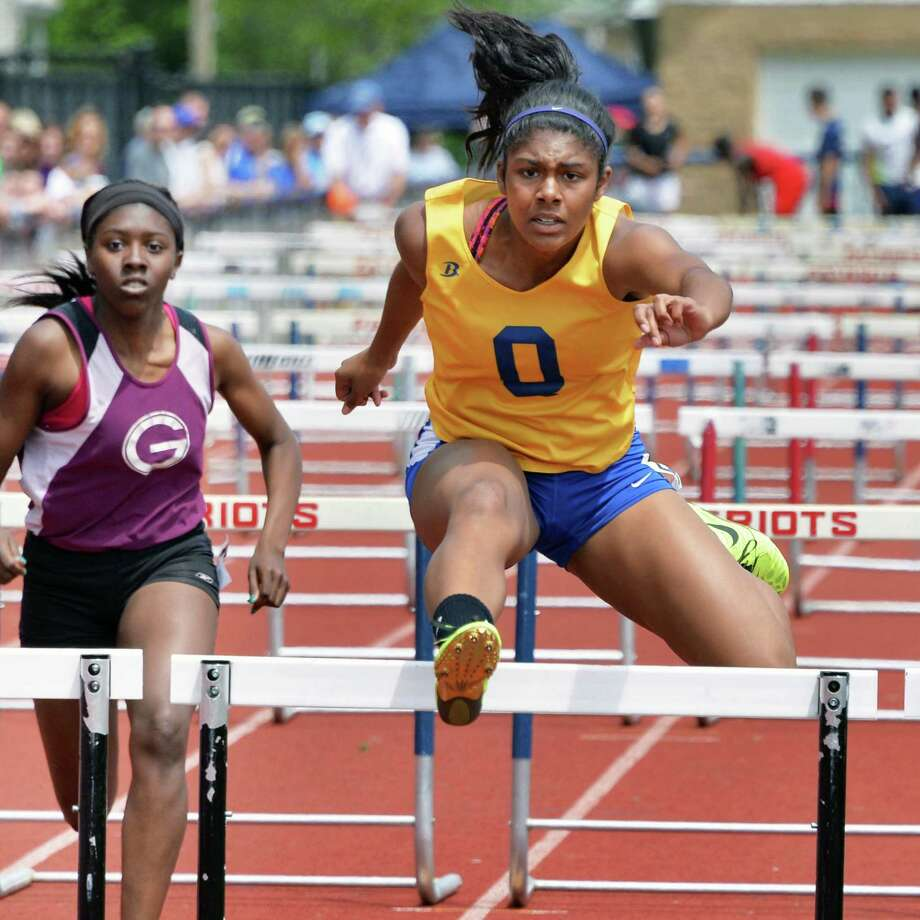 Queensbury's Nikari Carota on her way to winning the girls 100m hurdles final during the annual high school track and field Eddy Meet at Schenectady High School in Schenectady, NY Saturday May 18, 2013.  (John Carl D'Annibale / Times Union) Photo: John Carl D'Annibale / 00022412A