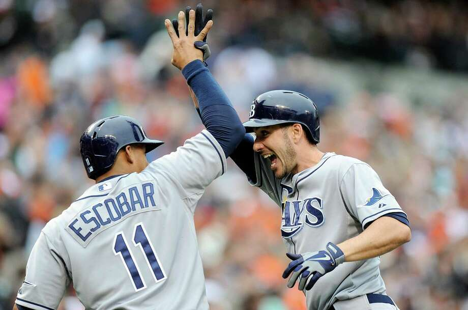 Tampa Bay's Matt Joyce, right, earns a high-five from Yunel Escobar after hitting a home run in the third inning of the Rays' 10-6 victory at Baltimore on Saturday. Joyce, who had five RBIs, had a two-run double in Tampa Bay's six-run ninth. Photo: Greg Fiume, Stringer / 2013 Getty Images