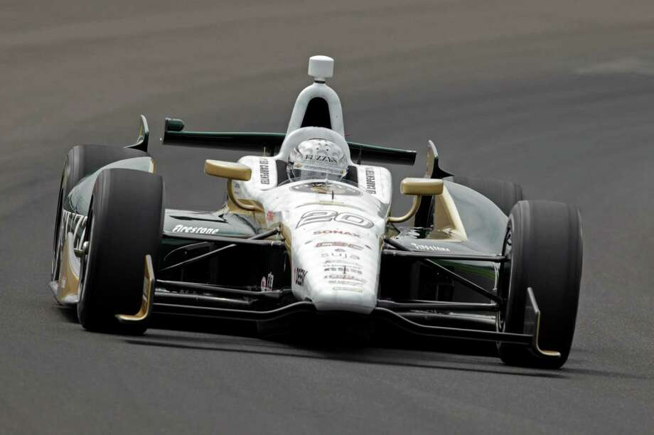 Ed Carpenter drives through the first turn on his qualification run on the first day of qualifications for the Indianapolis 500 auto race at Indianapolis Motor Speedway in Indianapolis, Saturday, May 18, 2013. (AP Photo/AJ Mast) Photo: AJ Mast