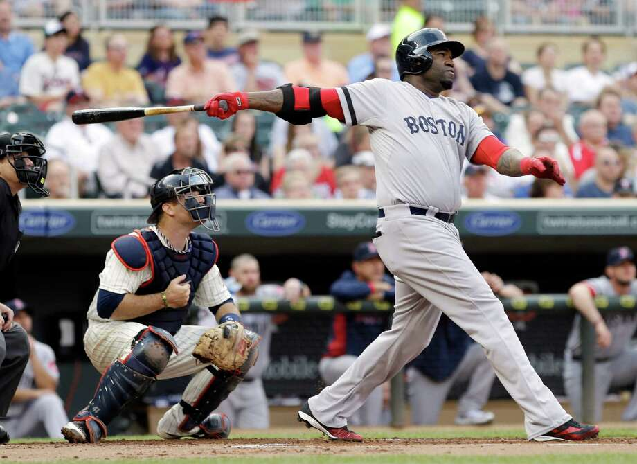Boston Red Sox's David Ortiz follows through on a three-run home run off Minnesota Twins starting pitcher Scott Diamond in the first inning of a baseball game, Saturday, May 18, 2013, in Minneapolis. At left is Twins catcher Ryan Doumit. (AP Photo/Jim Mone) Photo: Jim Mone