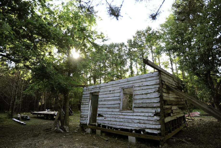 The Smithsonian Institution is dismantling this one-time antebellum slave cabin on Edisto Island, S.C. It will be a featured artifact in the National Museum of African-American History and Culture. Photo: Photos By Stephen Morton / New York Times