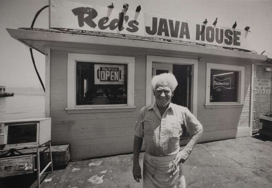 "Former owner of Red's Java House Tom ""Red"" McGarvey stands in front of the port side cafe during the latter years of ownership. (photo courtesy/ Tom McGarvey)"