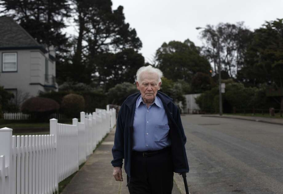 "Determined to get back to the golf course some day, former owner of Red's Java House Tom ""Red"" McGarvey, 85, walks his Lakeside District neighborhood every day in San Francisco."