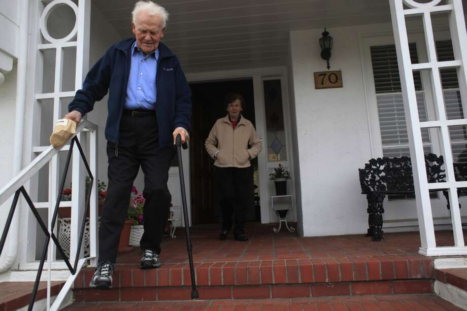 """With his wife of 55 year, Nancy waiting for him, former owner of Red's Java House Tom """"Red"""" McGarvey, 85, start his afternoon walk in San Francisco."""