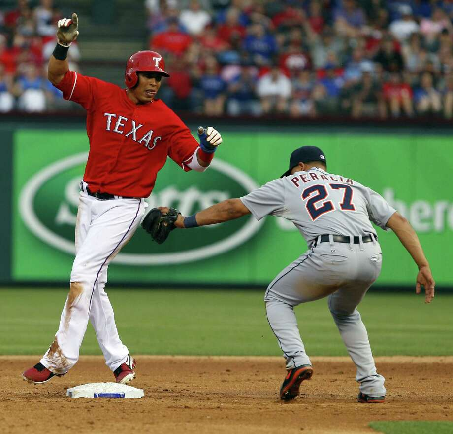 The Rangers' Leonys Martin beats the tag of Tigers shortstop Jhonny Peralta to steal second base in the second inning in Arlington. Martin has four steals in five attempts this year. Photo: Photos By Richard Rodriguez / Fort Worth Star-Telegram