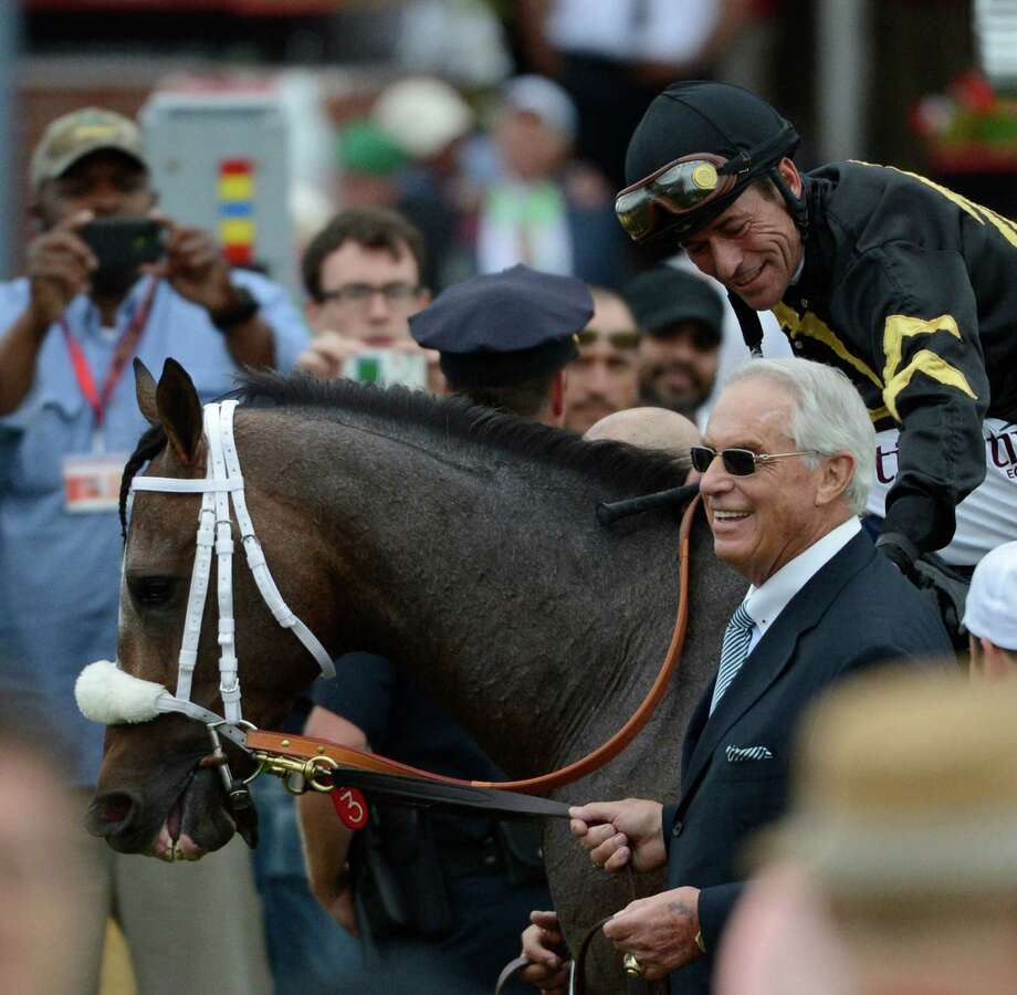 Oxbow ridden by veteran jockey Gary Stevens is lead to the winner's circle by trainer D. Wayne Lukas after winning the 138th running of the Preakness Stakes May 18, 2013 at historic Pimlico Race Course in Baltimore, Maryland.  This was the second jewel of the thoroughbred racing's triple crown.  Kentucky Derby winner Orb finished fourth.   (Skip Dickstein/Times Union) Photo: SKIP DICKSTEIN
