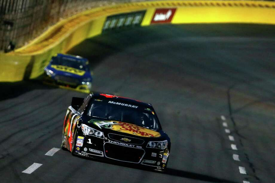 Jamie McMurray (front) leads Ricky Stenhouse Jr. during the NASCAR Sprint Cup All-Star race at Charlotte Motor Speedway in Concord, N.C. Photo: Kevin C. Cox / Getty Images
