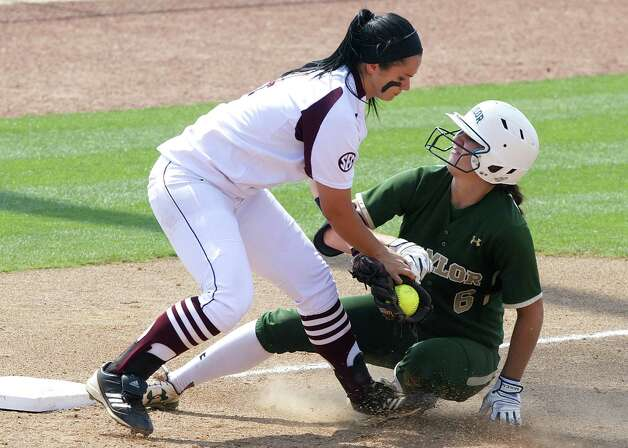 A&M third baseman Amber Garza tags out Baylor's Holly Holl during the sixth inning Saturday in College Station. Garza finished 1 for 4 and scored a run. Photo: Stuart Villanueva / Bryan-College Station Eagle