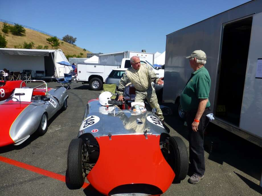 Steve Kupferman, of Rancho Murieta, Calif., talks to mechanic Mike Singleton (in green shirt) about Kupferman's 1958 V.A.Y. Special, powered by a 948cc BMC engine. (All photos by Michael Taylor)
