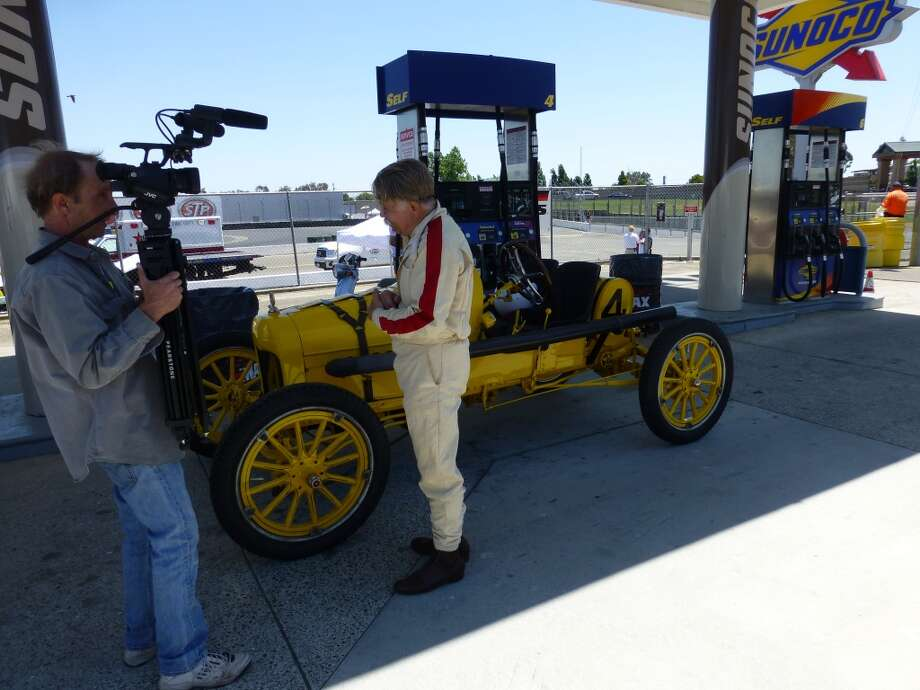 Ed Archer of Hayward, Calif., talking about his 1915 modified Ford Model T, shortly before tackling the front-mounted crank to get the car started. It took a few cranks before the engine caught.