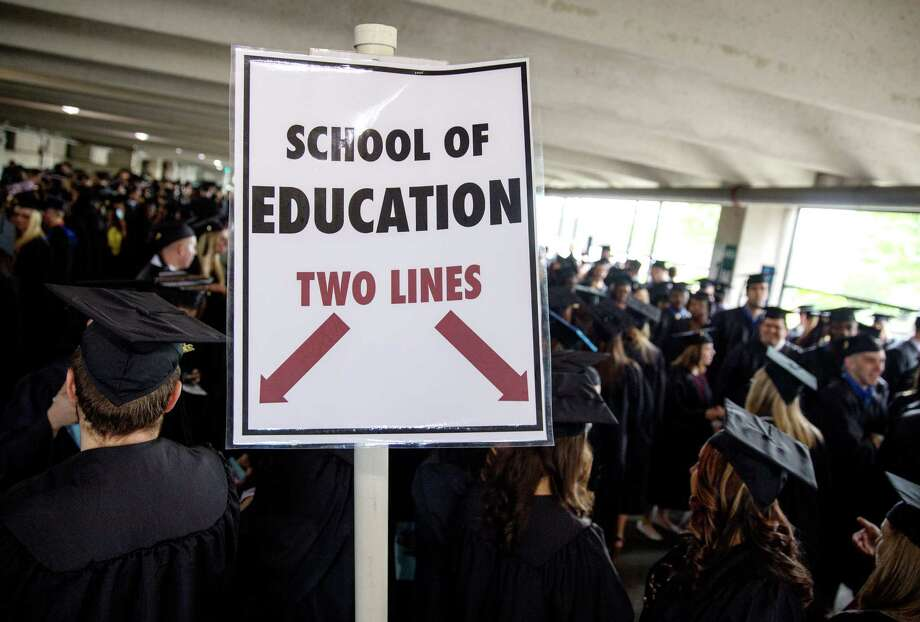 "Mike Ross Connecticut Post freelance -A sign for ""School of Education""  at stagging area for Southern Connecticut State University commencement excerises on Friday morning at Webster Bank Arena in Bridgeport. Photo: Mike Ross / Connecticut Post contributed"