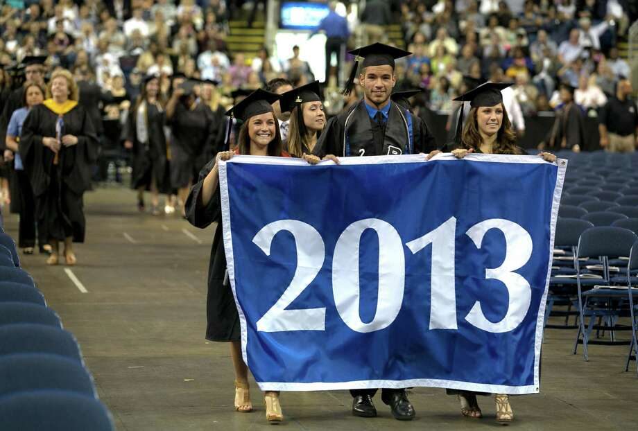 Mike Ross Connecticut Post freelance -Southern Connecticut State University Senior Class Officers Amanda McAndrew, Nicholas Gleifert and Jessica Luczkow lead the processional during Friday morning commencement at Webster Bank Arena in Bridgeport. Photo: Mike Ross / Connecticut Post contributed