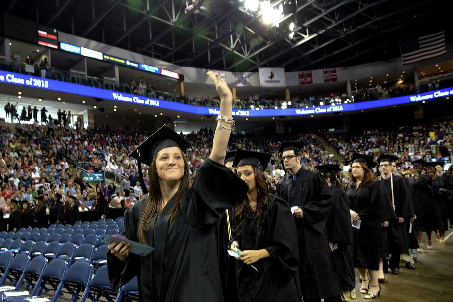 Mike Ross Connecticut Post freelance -Southern Connecticut State University student Lauren Mangeri of Windsor Locks waves to family and friends in audience as she and other students make their way into Webster Bank Arena at Friday morning commencement exercises. Photo: Mike Ross / Connecticut Post contributed