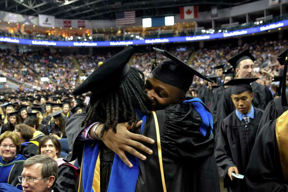 Mike Ross Connecticut Post freelance -Southern Connecticut State University student Daniel Ndamwizeye who goes by Daniel Trust hugs Professor of Sociology Shirley A. Jackson during Friday morning commencement exercise at Webster Bank Arena. Trust is a Rwandan refugee. He is from Bridgeport and graduated from Bassick High and is working at TD Bank in Fairfield. He was orphaned as a young boy during the Rwandan genocide of 1994. His mother was beaten to death when he was 5 years old, and his father and sisters were also killed. Somehow Daniel survived. He went with his sisterâÄôs finance to Zambia when he was 11. Four years later, he got a visa to come to the U.S. He will be getting a bachelorâÄôs degree in business administration. Photo: Mike Ross / Connecticut Post contributed