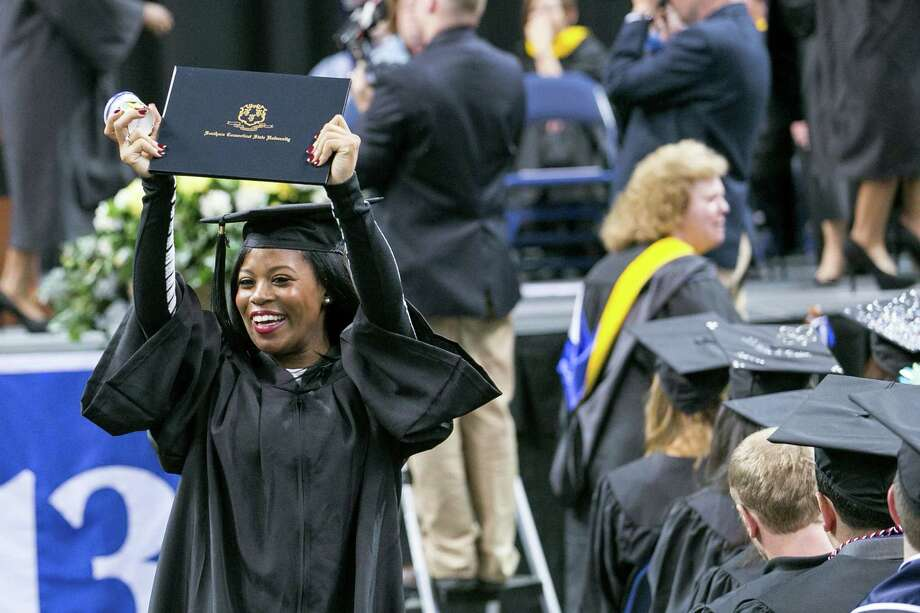 Mike Ross Connecticut Post freelance -Southern Connecticut State University student Tyniqua Carey of Plainville, Ct proudly shows off her diploma during Friday morning commencement excerises at Webster Bank Arena. Carey received a BA in Business Adminstration. Photo: Mike Ross / Connecticut Post contributed