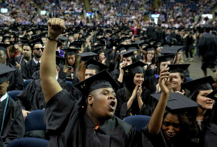 Mike Ross Connecticut Post freelance -Southern Connecticut State University student Ronald Huggins of New Haven celebrates during Friday morning commencement excerises at Webster Bank Arena. Photo: Mike Ross / Connecticut Post contributed