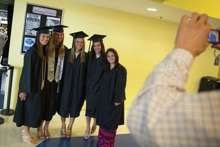 Mike Ross Connecticut Post freelance -Southern Connecticut State University students pose for a group photo during Friday morning commencement excerises at Webster Bank Arena. Photo: Mike Ross / Connecticut Post contributed