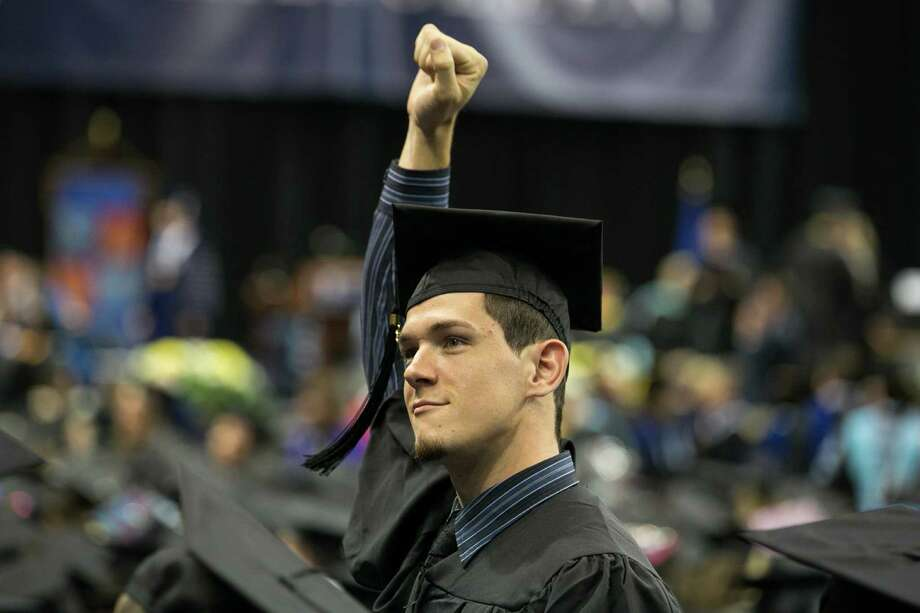 Mike Ross Connecticut Post freelance -Southern Connecticut State University student celebrates during Friday morning commencement excerises at Webster Bank Arena. Photo: Mike Ross / Connecticut Post contributed