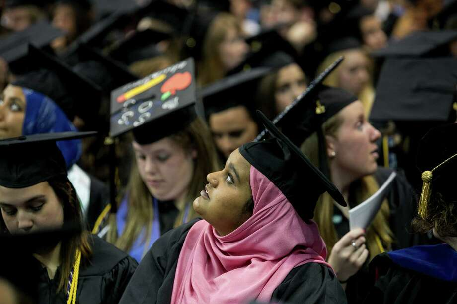 Mike Ross Connecticut Post freelance -Southern Connecticut State University student looks for family members in audience during Friday morning commencement exercises at Webster Bank Arena in Bridgeport. Photo: Mike Ross / Connecticut Post contributed