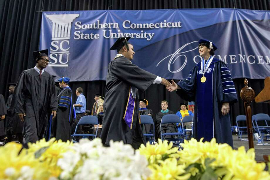 Mike Ross Connecticut Post freelance -Southern Connecticut State University President Mary A. Papazian shakes the hands of students during Friday morning commencement exercises at Webster Bank Arena. Photo: Mike Ross / Connecticut Post contributed