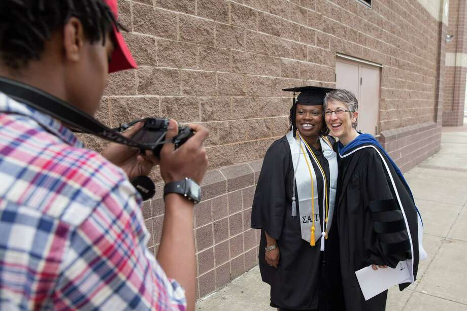 Mike Ross Connecticut Post freelance -Southern Connecticut State University graduate Ginger Price of Meriden posess for a photo with her professor Dr. Liz Keenan during Friday morning commencement excerises at Webster Bank Arena. Photo: Mike Ross / Connecticut Post contributed