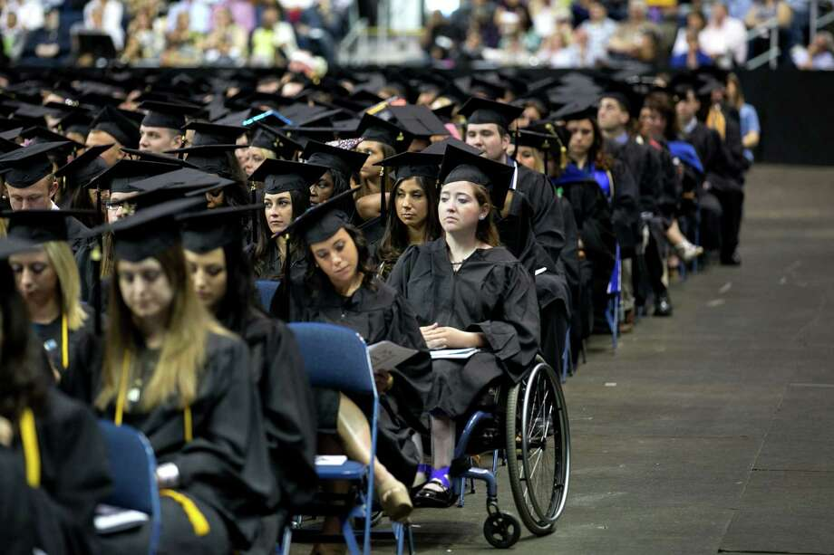 Mike Ross Connecticut Post freelance -Southern Connecticut State University graduate Ashley Carver of Meriden listen during Friday morning commencement excerises at Webster Bank Arena. Carver received a BA in Therapeutic Recreation. Photo: Mike Ross / Connecticut Post contributed