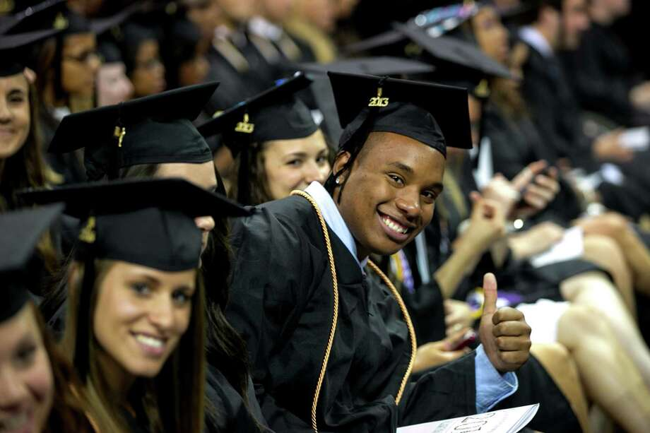 Mike Ross Connecticut Post freelance -Southern Connecticut State University students during Friday morning commencement exercises at Webster Bank Arena in Bridgeport. Photo: Mike Ross / Connecticut Post contributed